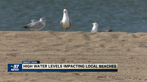 Beaches get smaller as Lake Michigan water levels continue to...