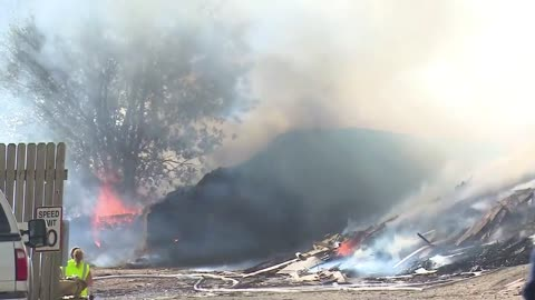 Nearby businesses continue to worry as mulch fire burns over 30 hours