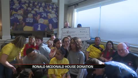 Clay firefighters present check, cook Easter meal at Ronald McDonald...