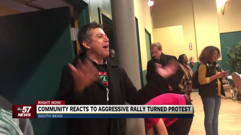 Community members talk protesters at Mayor Pete rally