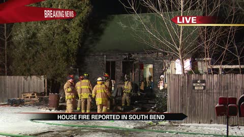 Firefighters battle house fire near South Bend