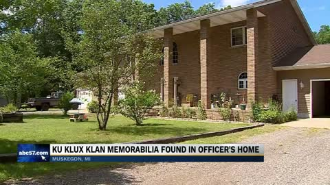 Michigan officer under investigation after KKK items found in home