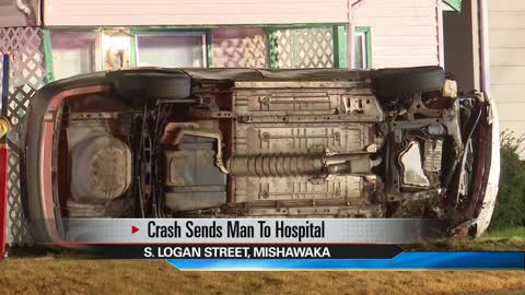 Crash results in car rolling over on front lawn in Mishawaka