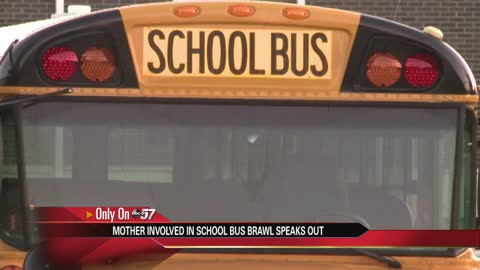 Mother involved in school bus fight says she was protecting daughter