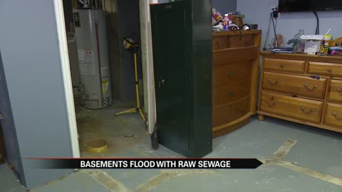 Neighbors want answers after basements flood with raw sewage
