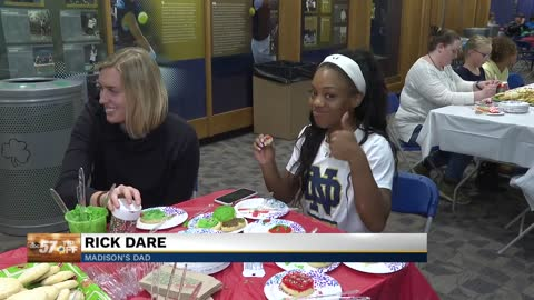Notre Dame players bring Christmas joy to children at local hospitals