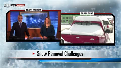 Piles of snow, snow covered cars causing traffic problems in some parts of South Bend