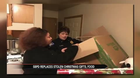 South Bend police officers buy presents for family burglarized before Christmas