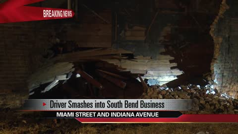 Police searching for driver after pickup truck crashes into business