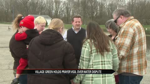 Residents at Village Green hold prayer vigil over water dispute