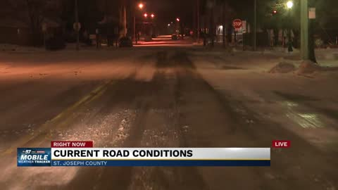 Road conditions remain slick as lake effect snow tapers off