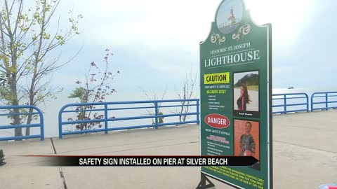 Safety sign installed on pier at Silver Beach