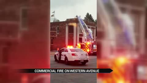 Crews work to put out building fire on Western Avenue