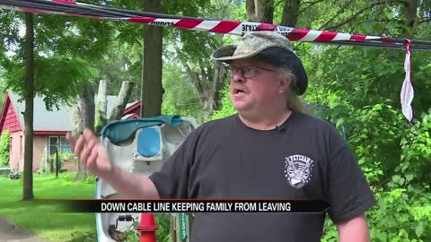 South Bend man trapped in by downed wire