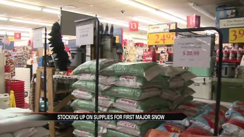 Folks stock up on supplies for first major snow of the season