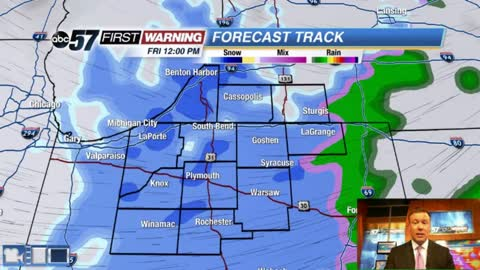 Falling temperatures, still breezy and a chance of snow