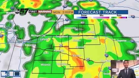 Scattered showers and a storm today into Tuesday
