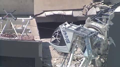 At least 1 dead, 6 injured after crane falls on Dallas apartment building