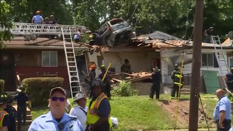 Car crashes into roof of home in St. Louis