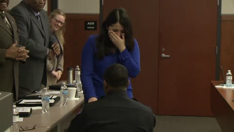 New officer proposes right after being sworn-in