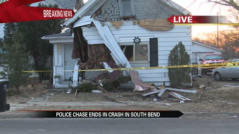 Vehicle fleeing police crashes into home in South Bend