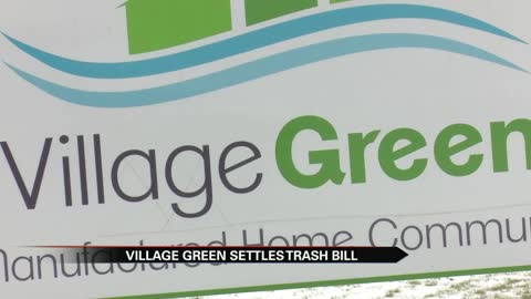 Village Green settles trash bill