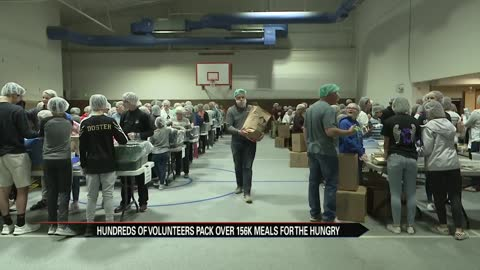 Volunteers at Clay Church put together thousands of meals for...