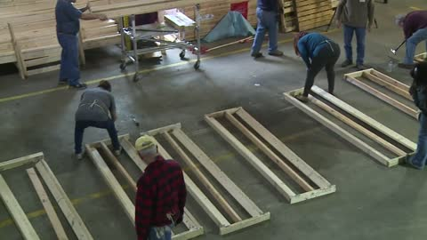 Volunteers build walls for Habitat homes