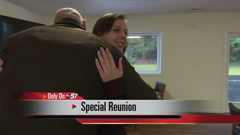 Woman reunites with officer who saved her from burning car