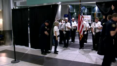 Flight of Champions Honor Flight returns to crowd full of people...