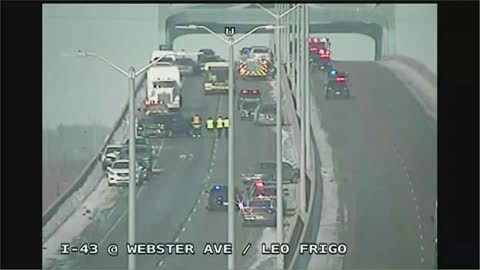 Multiple injuries in bridge crash involving 30 vehicles