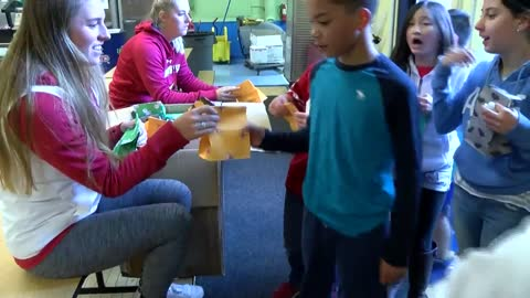Badgers give back: Student athletes visit pen-pals at Randall Elementary
