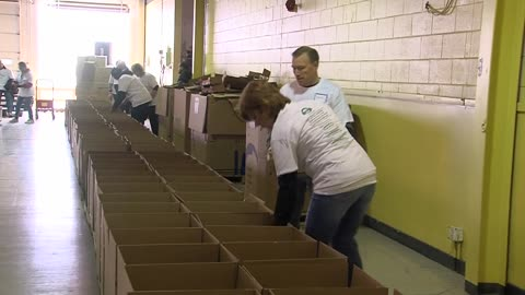 Palermo's and Hunger Task Force pack boxes for Easter