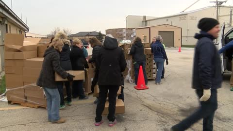 Cars line up at Hunger Task Force to deliver donated food
