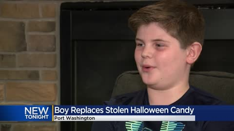 Port Washington boy puts own candy into empty bowl while trick-or-treating