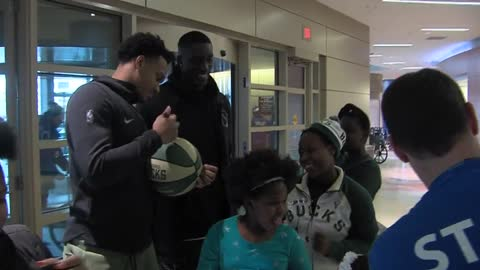 Milwaukee Bucks surprise patients at Children's Hospital of Wisconsin with presents