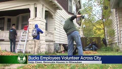 Milwaukee Bucks' staff helps rake and fix up homes as part...