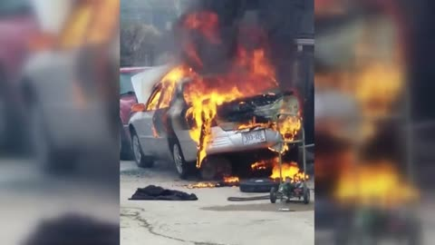 Person injured after car catches fire, spreads to garage