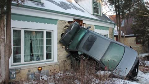 Car launches into house in Tosa
