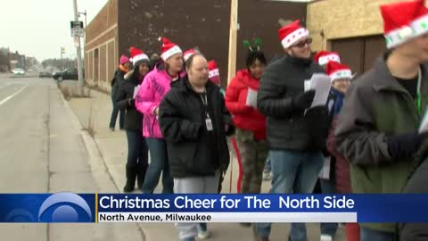 Carolers spread Christmas cheer down North Avenue