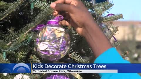 Students decorate Cathedral Square Park for Holiday Lights Festival
