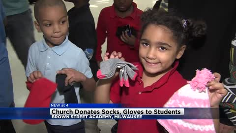Church donates gloves, hats, and socks to Brown Street Academy students