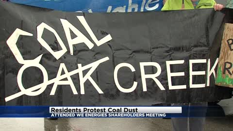 Residents hold demonstration on coal dust ahead of WEC Energy Group meeting