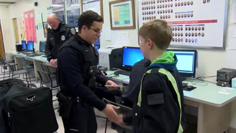 Dane County boy hands out coins to honor police officers