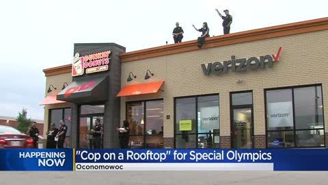 "Police officers sit atop Dunkin' Friday for annual ""Cop on a Rooftop"" fundraiser"