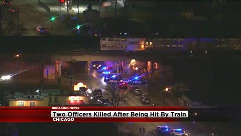 2 officers die after being struck by train