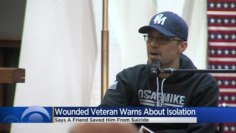 Marine Corps veteran Noah Currier speaks at VA Veterans Day ceremony