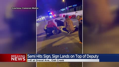 Deputy injured after semi strikes downed signboard near I-41...