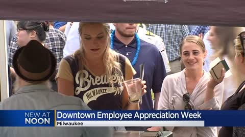 "Workers enjoy ""world's largest coffee break"" during Downtown..."