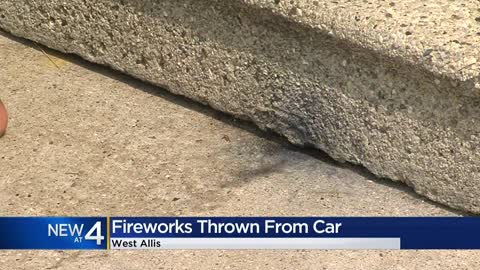 West Allis Police investigating after two neighbors say someone threw a firework at them